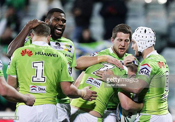Raiders players celebrate during the round 25 NRL match between the Canberra Raiders and the Penrith Panthers at GIO Stadium on August 31 2015 in...