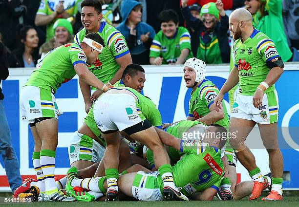 Raiders players rejoice after Jordan Rapana score a golden point try during the round 17 NRL match between the Canberra Raiders and the Newcastle...