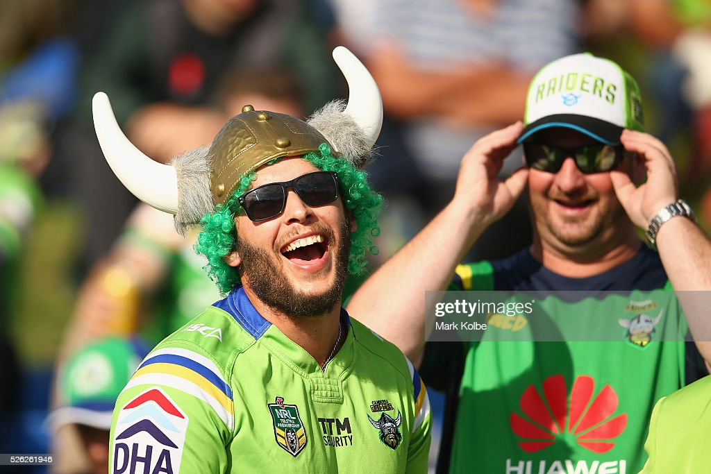 Raiders supporters share a laugh as they watch on before kick-off of the round nine NRL match between the Penrith Panthers and the Canberra Raiders at Carrington Park on April 30, 2016 in Bathurst, Australia.
