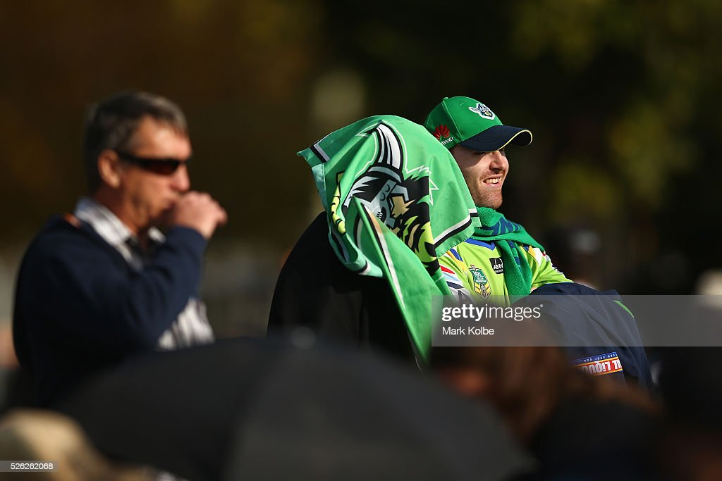 Raiders supporters watch on before kick-off of the round nine NRL match between the Penrith Panthers and the Canberra Raiders at Carrington Park on April 30, 2016 in Bathurst, Australia.