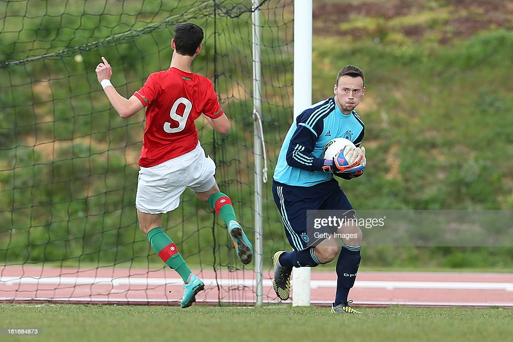 Raif Husic of Germany gathers the ball as Marcio Martins of Portugal makes a challenge during the Under17 Algarve Youth Cup match between U17 Portugal and U17 Germany at the Stadium Bela Vista on February 12, 2013 in Parchal, Portugal.