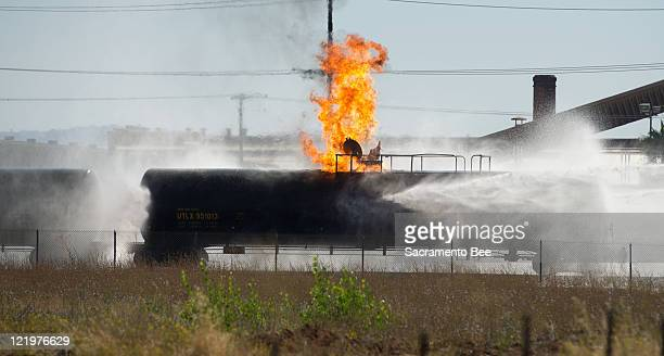 A rail car containing propane continues to burn Wednesday afternoon on August 24 in Lincoln California With the help of specialists out of Texas fire...