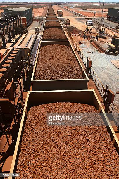 Rail cars laden with iron ore arrive at the receiving facility at Fortescue Metals Group Ltd's Herb Elliott Port in Port Hedland in the Pilbara...