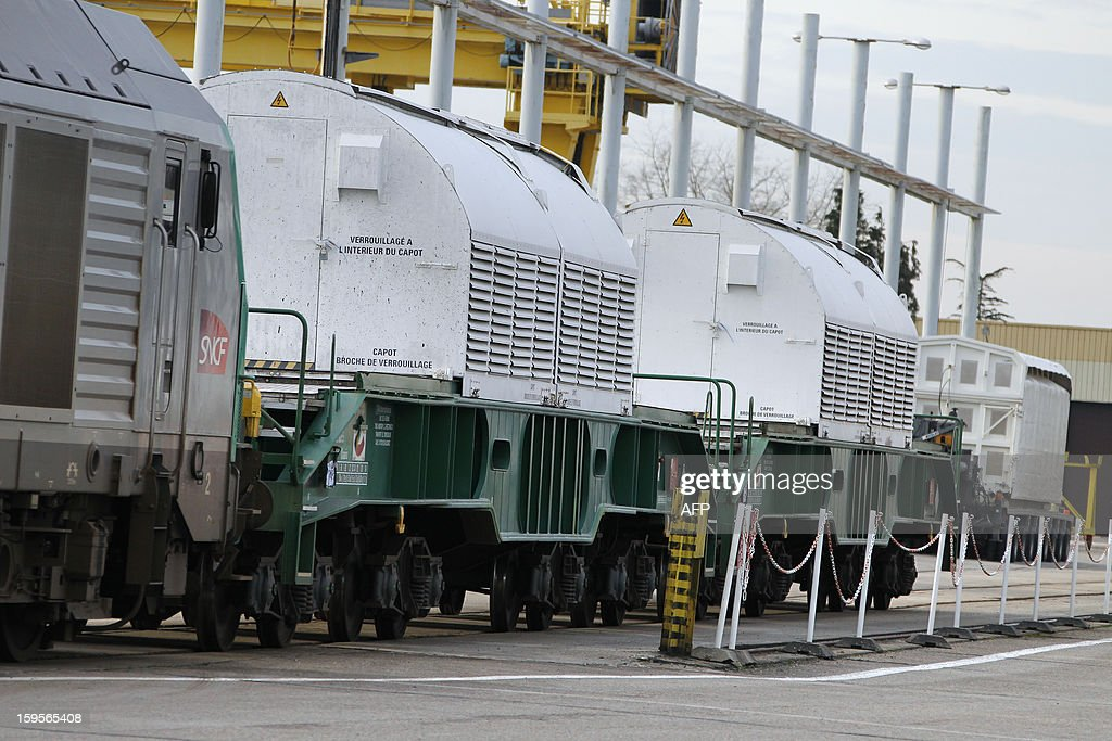 A rail convoy carrying highly radioactive spent nuclear waste from Italy to the retreatment factory of La Hague arrives at the French energy giant Areva retreatment factory of Valognes, northwestern France on January 16, 2013. AFP PHOTO/CHARLY TRIBALLEAU