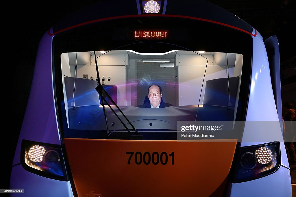 Rail Minister Stephen Hammond sits in the drivers cab of a mock up of a new electric Class 700 Thameslink passenger train unveiled at ExCel on January 28, 2014 in London, England. The train will run on London's £6.5 billion GBP expansion of the Thameslink line which, when completed, will allow passengers to reach destinations north and south of the capital without stopping.