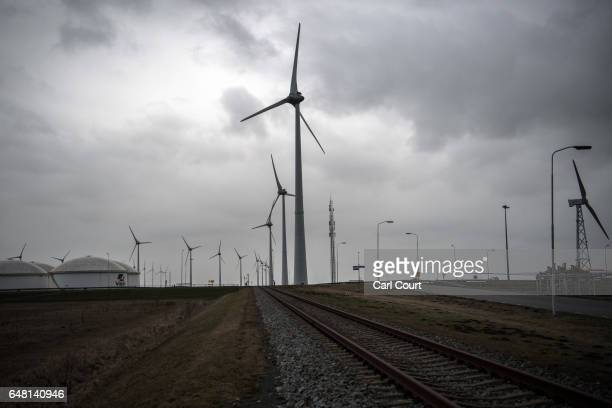 A rail track passes wind turbines on February 23 2017 in Eemshaven Netherlands The Dutch will vote in parliamentary elections on March 15 in a...