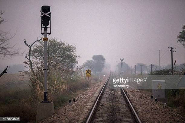 Rail tracks pass through a clearing where Kamlesh her family and other villagers go to defecate in Lahli village Haryana India on Tuesday Nov 3 2015...