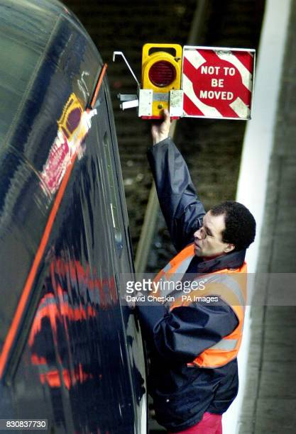 A rail worker attaches a sign to a train at Edinburgh's Waverley Station as commuters faced the first day of a wave of train strikes across Scotland...