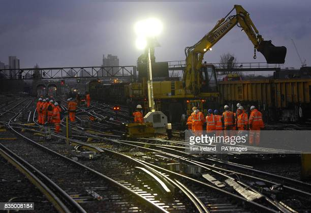 Rail workers on the tracks at London's Clapham Junction