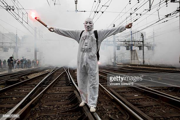 Rail workers who demonstrate against the new Labour Law known as the 'ElKhomri Law' invade the rails of the Montparnasse train station on June 6 2016...