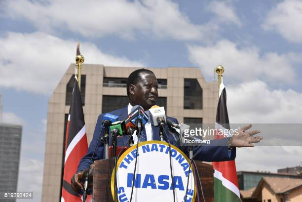 Raila Odinga opposition leader and presidential candidate for the National Super Alliance gestures as he speaks during a news conference at his...