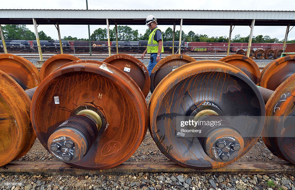 Railcar foreman <a gi-track='captionPersonalityLinkClicked' href=/galleries/search?phrase=James+Harper&family=editorial&specificpeople=609200 ng-click='$event.stopPropagation()'>James Harper</a> inspects new roller bearing axles at the Florida East Coast Railway 's (FEC) Bowden Yard in Jacksonville, Florida, U.S., on Monday Sept. 23, 2013. The FEC is a 351-mile freight rail system along the east coast of Florida, connecting the ports of Miami, Fort Lauderdale and Palm Beach, which transports intermodal shipments, provides carload service and moves commodities, automobiles, bulk liquids, building materials, orange juice and electronics. Photographer: Mark Elias/Bloomberg via Getty Images