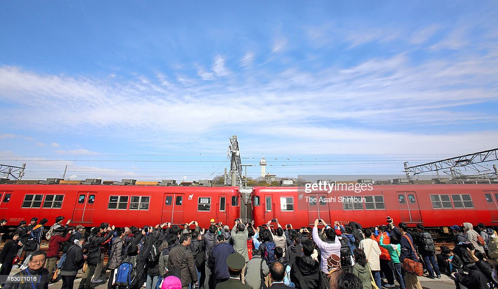 Railfans from around Japan take photographs the retired Meitetsu 6000 series on March 3, 2013 in Owariasahi, Aichi, Japan.