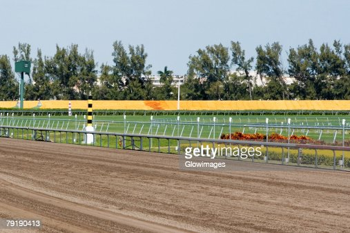 Railing along a horseracing track : Stock Photo