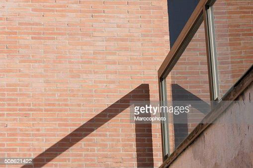 Railing and red brick wall : Stock Photo