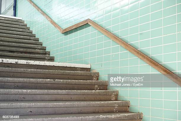 Railing On Turquoise Wall By Steps In Subway