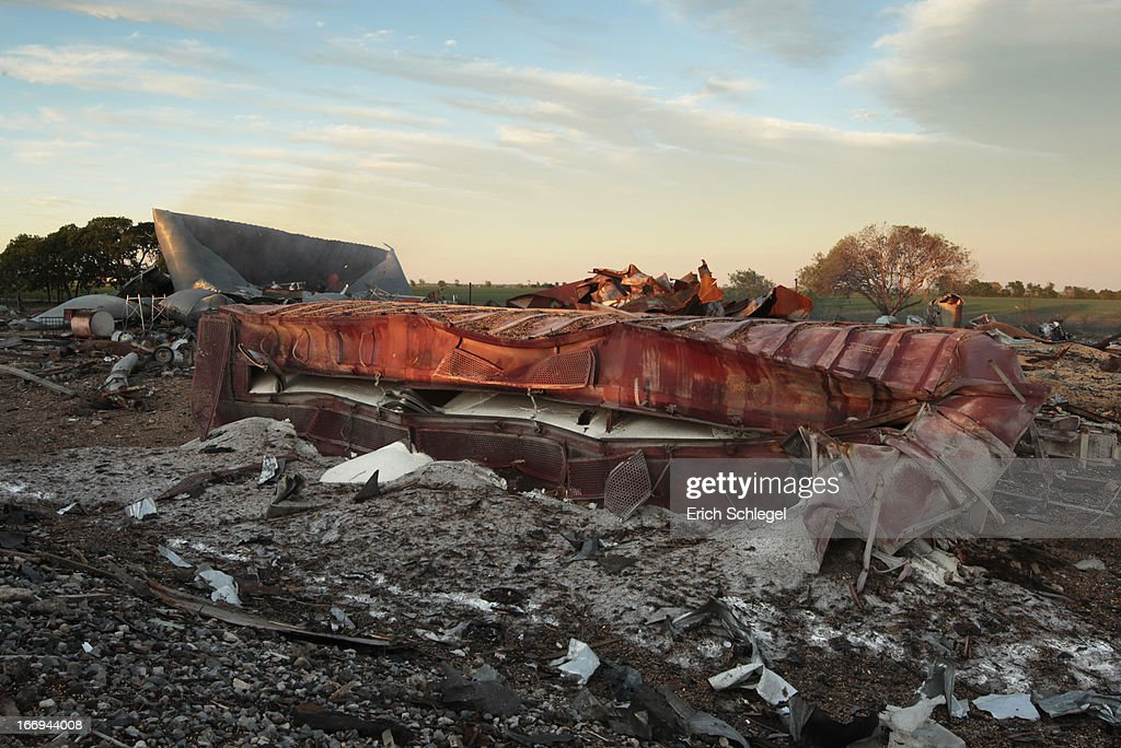 A railroad boxcar filled with ammonium nitrate lays on its side near to the remains of the fertilizer plant that exploded yesterday afternoon on April 18, 2013 in West, Texas. According to West Mayor Tommy Muska, around 14 people, including 10 first responders, were killed and more than 150 people were injured when the fertilizer company caught fire and exploded, leaving damaged buildings for blocks in every direction.