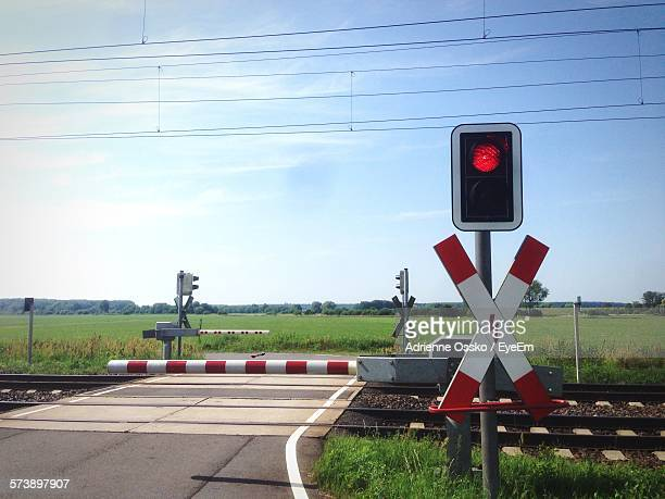 Railroad Crossing Against Sky