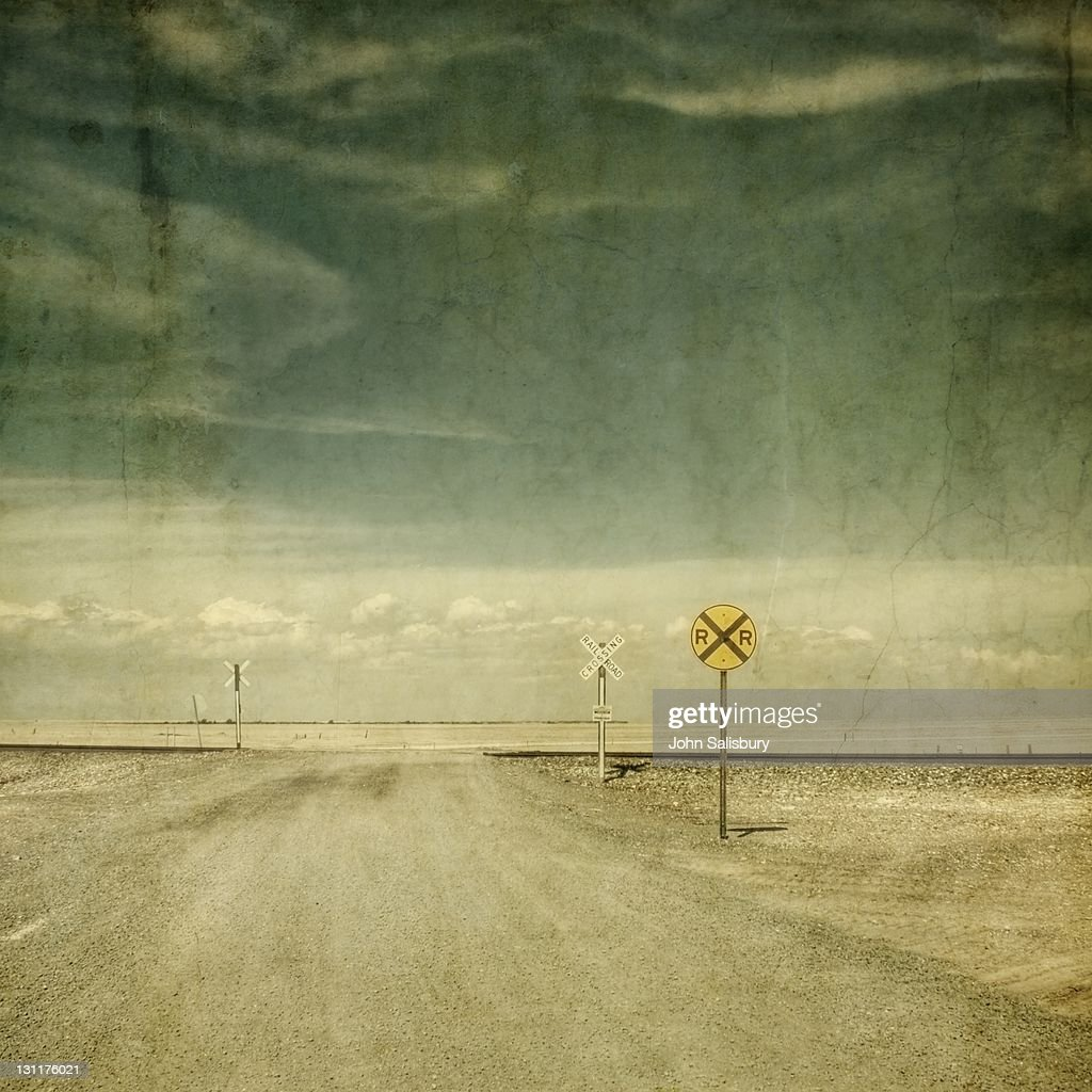 Railroad crossing in middle of Texas : Stock Photo