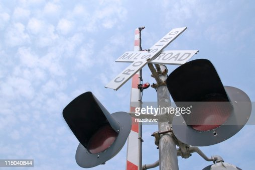 Railroad Crossing Signal Gate Lights with a Blue Sky : Stock Photo