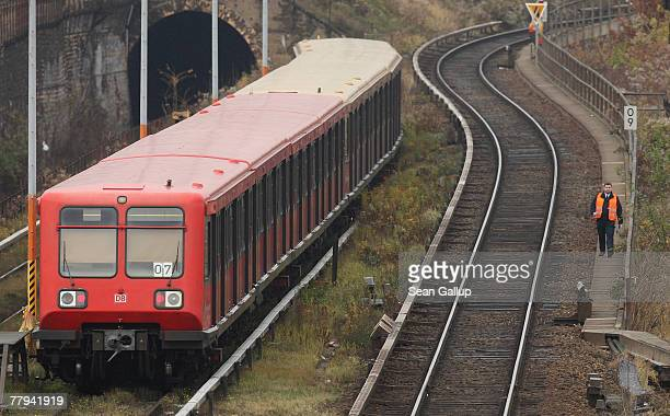 A railroad employee walks past an idle commuter SBahn train during a railroad strike November 16 2007 in Berlin Germany The GDL the German locomotive...