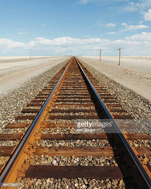 A railroad extending through the desert,near Wendover in Utah.