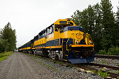 Railroad locomotive traveling across Alaska