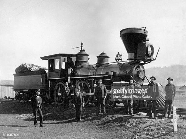 Railroad men in front of locomotive mid 1880s
