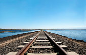 Railroad track against blue sky