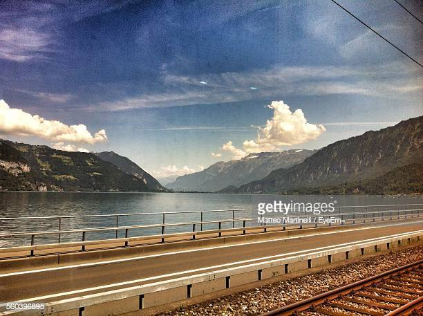 Railroad Track By Street Over Lake