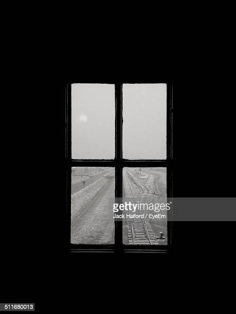 Railroad track through glass window