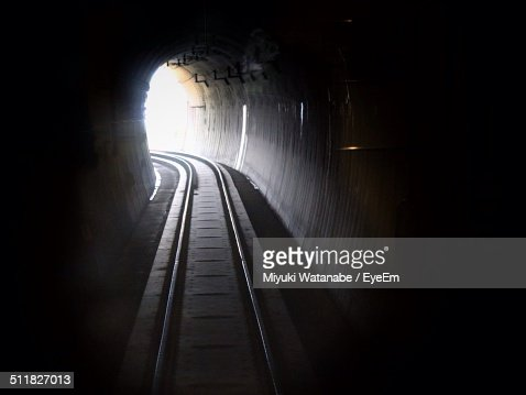 Railroad tracks passing through a tunnel