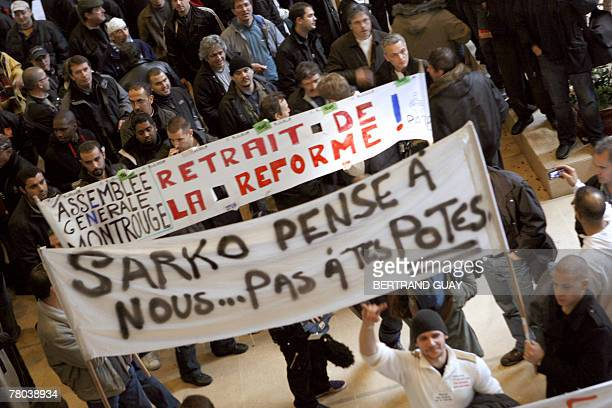 Rails workers in strike demonstrate during a tripartite meeting between the government the RATP management and trade unions 21 November 2007 at the...
