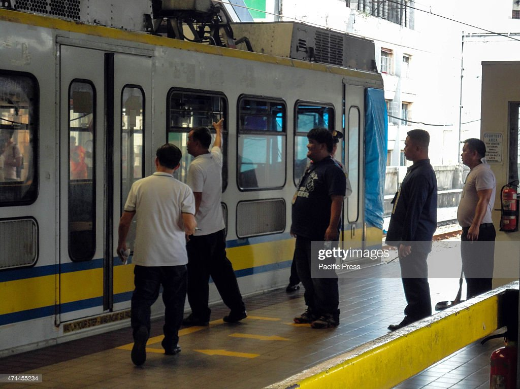 Railway authorities inspect a train at a railway station in Monumento as it prepares to go to the train depot in Pasay City south of Manila for...