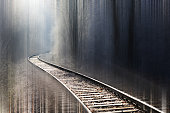 Railway line on a frosty day with snow and iced trees and shrubs. An motion blur photography with a sharp Railway line.