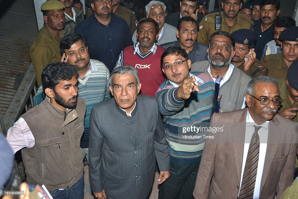 Railway Minister Pawan Kumar Bansal inspecting the Allahabad Railway station, the site of last night's stampede, during the Maha Kumbh Mela on February 11, 2013 in Allahabad, India. According to a government sources report, at least 36 people died in a stampede on a stair case as a train was pulling up on the busiest day of the Maha Kumbh Mela.