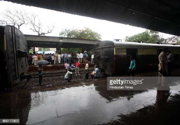 Railway Officials look at damaged railway track which derailed local train at Reay Road on Tuesday in Mumbai