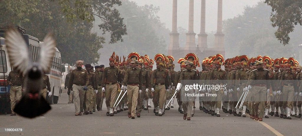 Railway police force rehearse march past for the upcoming Republic Day during the cold weather on January 5, 2013 in New Delhi, India. Delhi continued to shiver at a minimum of 2.9 degrees, four notches below normal. Over a 175 people have died so far in the bitter cold in Northern India.