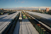 Railway station full of loaded freight trains in winter in Chelyabinsk Russia