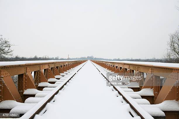 Railway track and bridge in winter snow