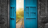 railway tracks behind open old door