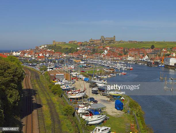 Railway tracks running alongside boats moored on the River Esk at Whitby