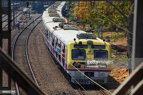 A railway train with new Bombardier powered rakes passes by Dadar Station on the Mumbai Suburban line on March 18 2015 in Mumbai India The new trains...