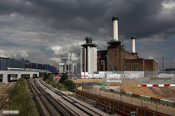 Railway trains pass near the Battersea power station residential and retail development site in London UK on Friday Aug 7 2015 Demand for London...
