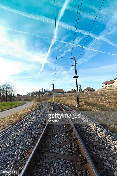 railway with plane trace in the sky