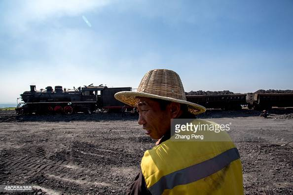 Railway workers are waiting for the steam train Their work is to lift and fortify the road base under the rail track Fuxin located in China's...