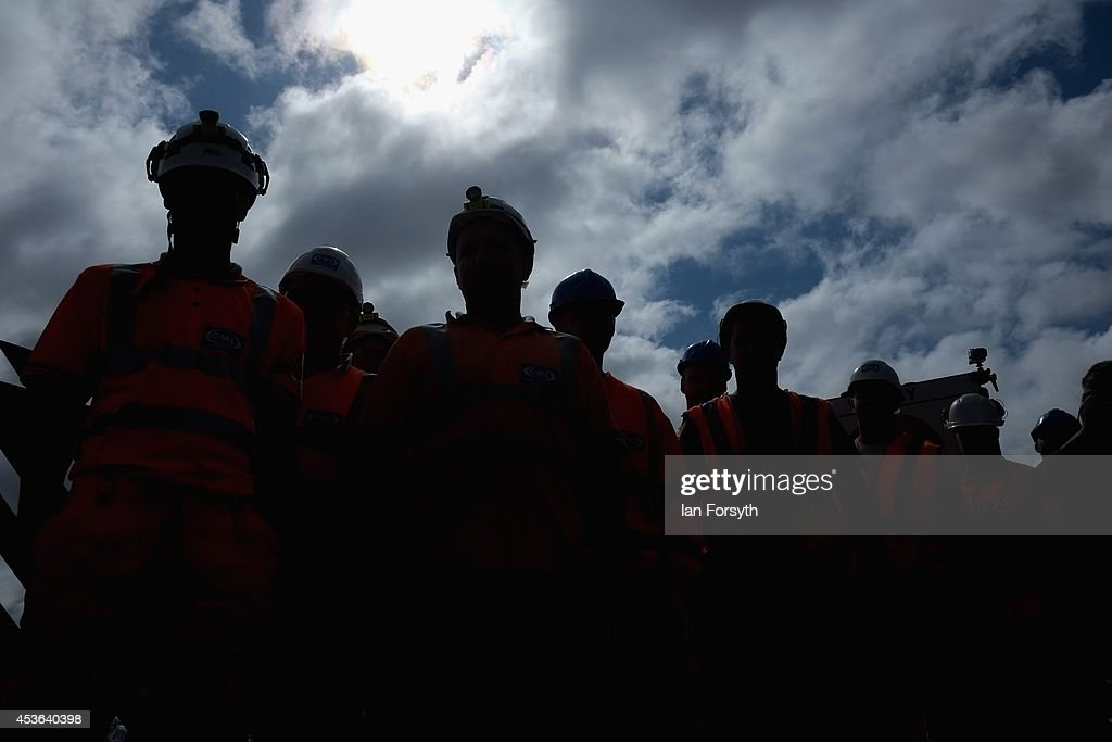 Railway workers look on during a ceremony to mark a second platform opening at Whitby train station on August 15, 2014 in Whitby, England. The second platform will provide passengers with more options for travel to the Yorkshire seaside town on the North Yorkshire Moors Railway and was the first time in half a century two steam locomotives were side by side at the station.