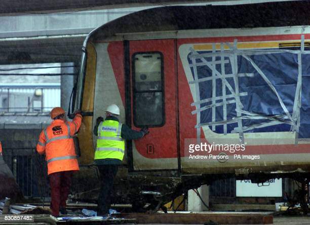 Railway workers remove a carriage from where it was lying across two platforms at Potters Bar station north of London The lift had been was put on...