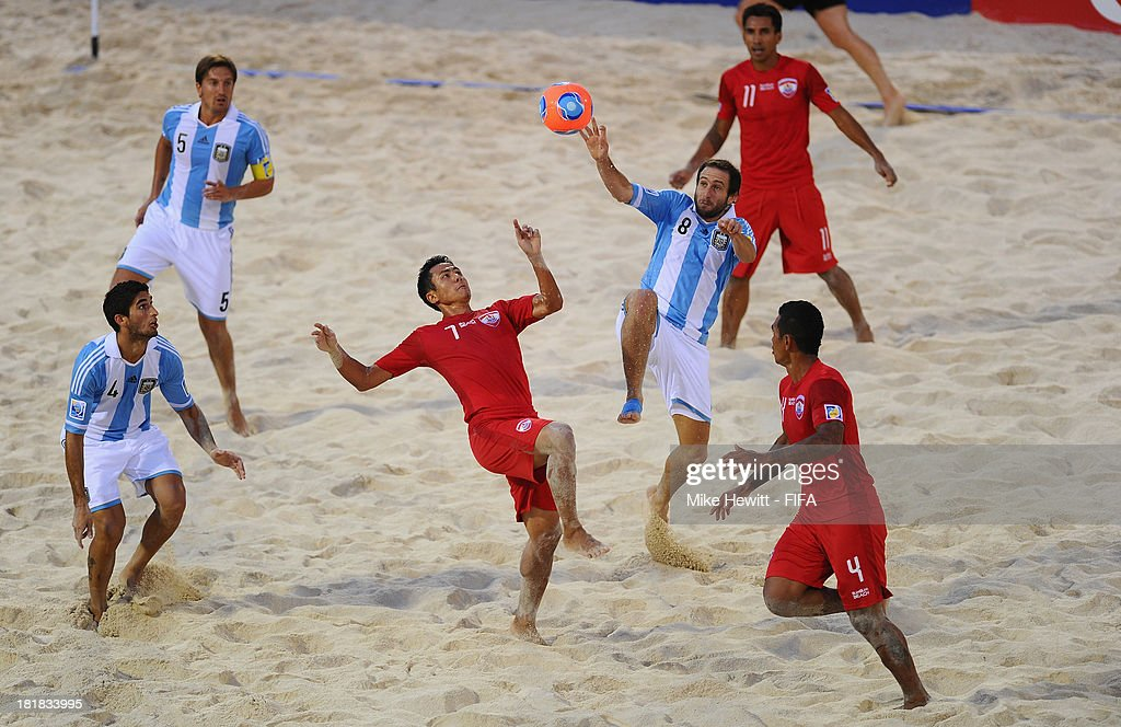 Raimana Li Fung Kuee of Tahiti is challenged by Federico Hilaire (8) of Argentina during the FIFA Beach Soccer World Cup Tahiti 2013 Quarter Final match between Argentina and Tahiti at the Tahua To'ata Stadium on September 25, 2013 in Papeete, French Polynesia.