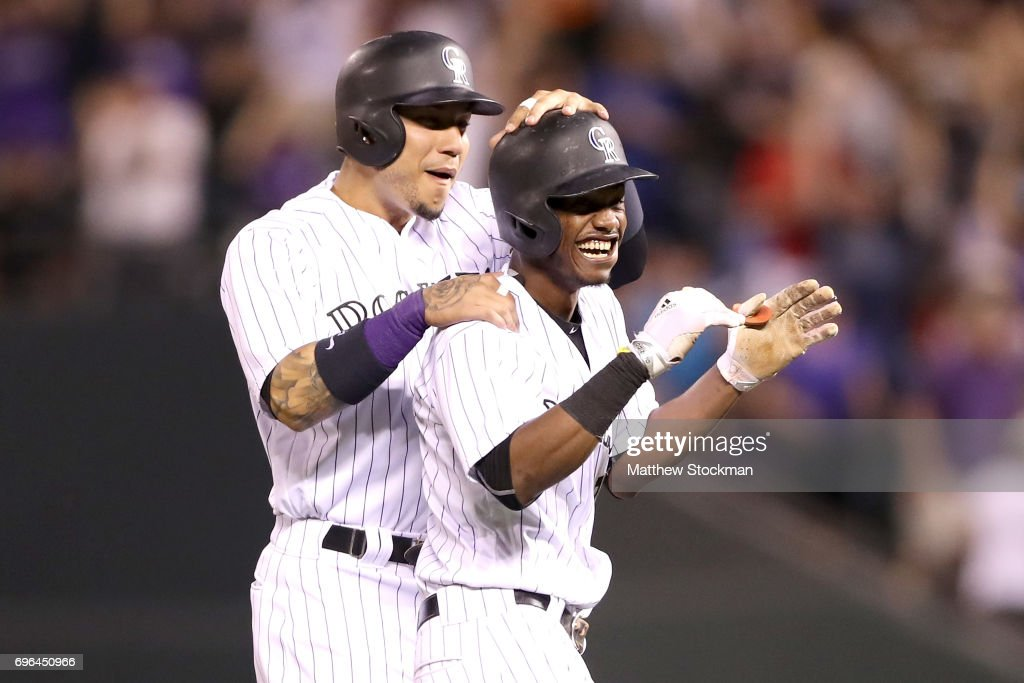 Raimel Tapia #7 of the Coloarado Rockies is congratulated by Carlos Gonzalez #5 after batting in the winning run in the bottom of the ninth inning against the San Francisco Giants at Coors Field on June 15, 2017 in Denver, Colorado.